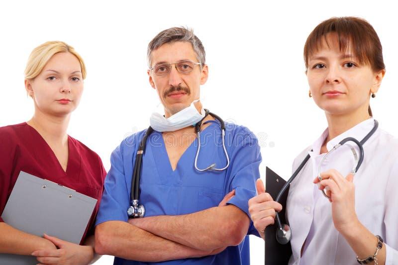 Doctores y enfermera fotografía de archivo libre de regalías