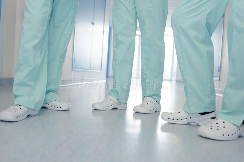 Doctores y enfermeras en equipo médico foto de archivo