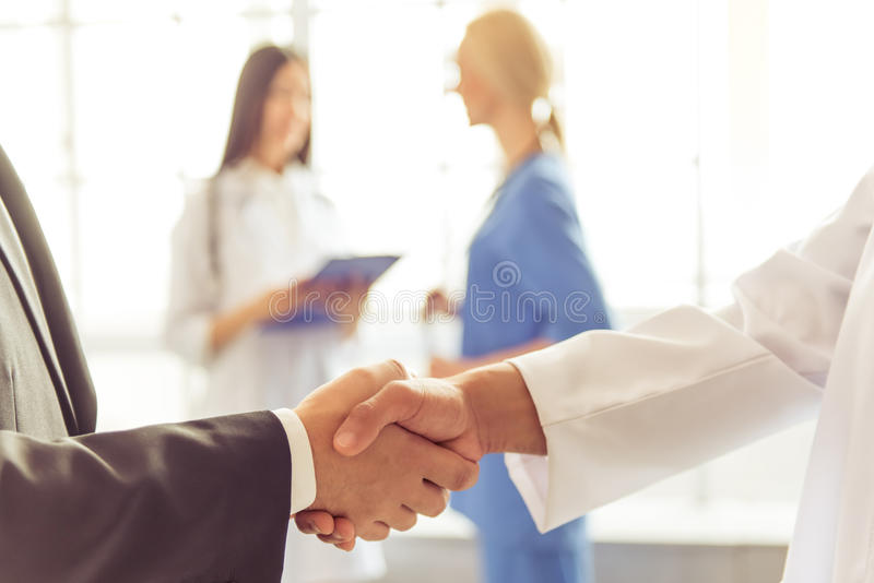 Doctors and businessman royalty free stock photography