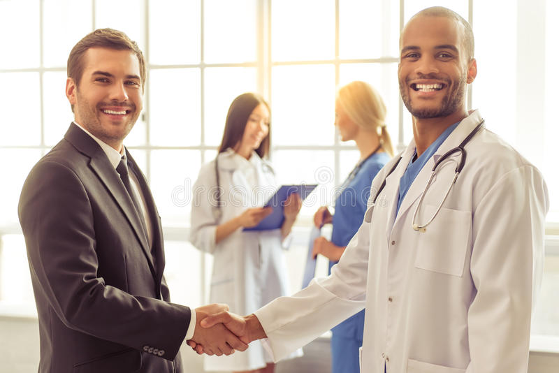Doctors and businessman royalty free stock photo