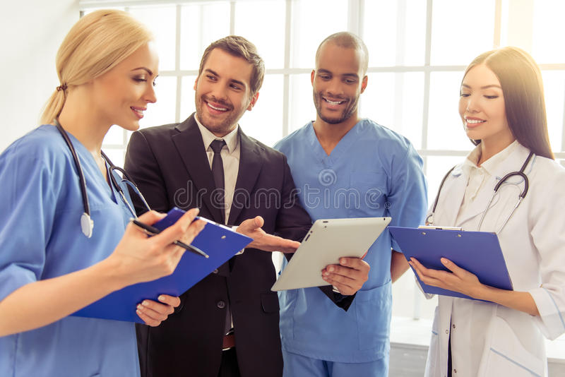 Doctors and businessman royalty free stock images