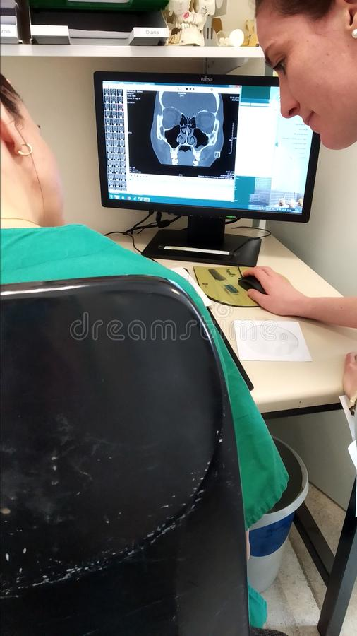 Doctors checking MRI on on the screen royalty free stock photos