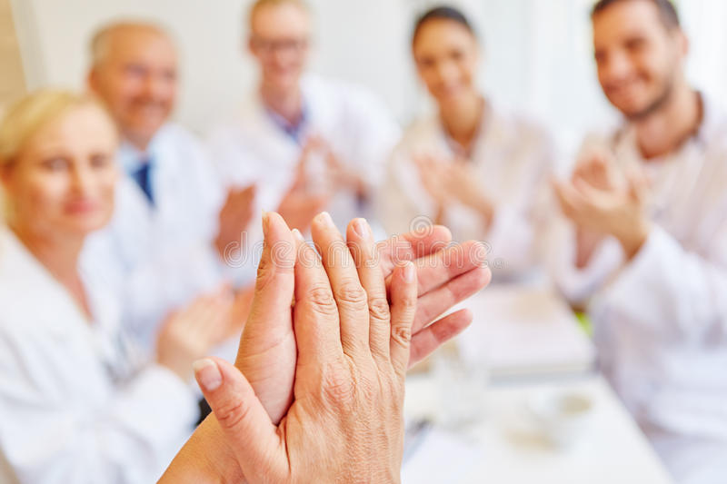 Doctors clapping hands royalty free stock photos