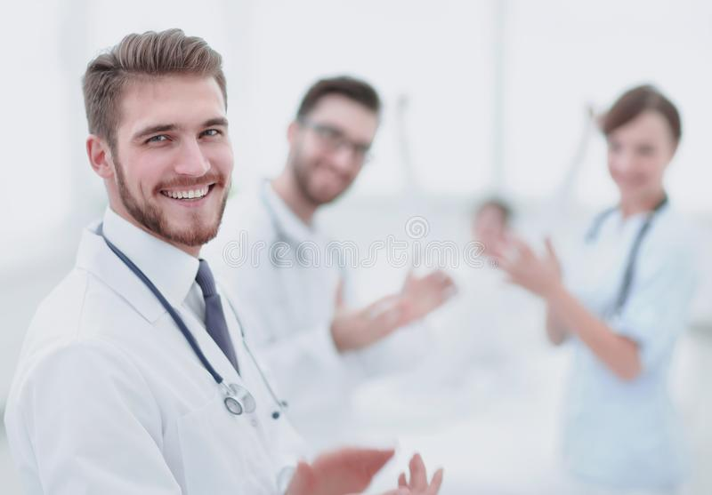 Doctors clapping hands and applauding on consent. Concept of success stock photography