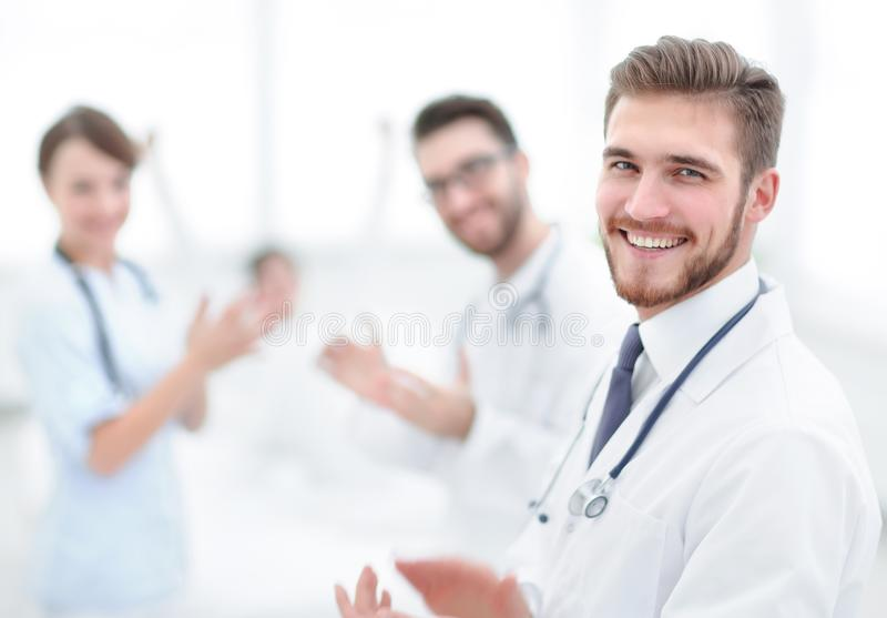 Doctors clapping hands and applauding on consent stock image