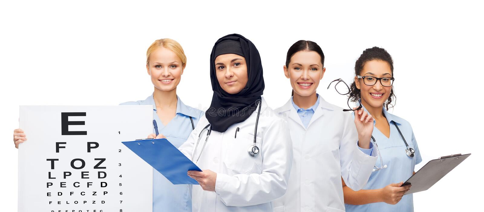 Doctors with clipboards, eye chart and glasses stock photo