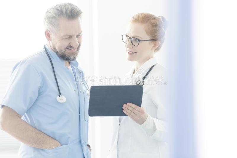Doctors consulting medical issue stock photos
