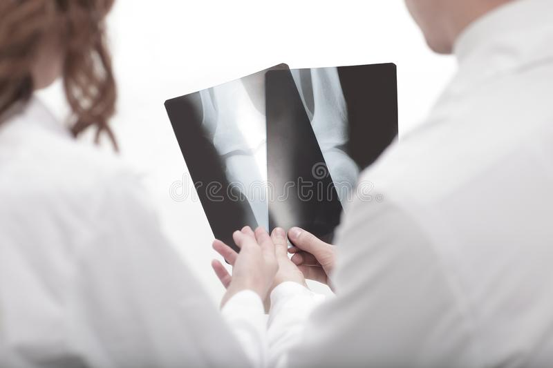 Doctors are diagnosticians discussing x ray of patient. Closeup.doctors are diagnosticians discussing x ray of patient royalty free stock photos