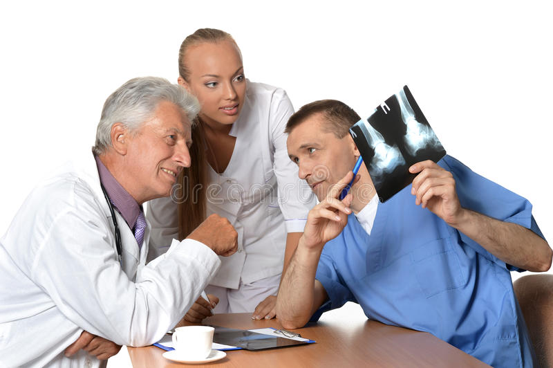 Doctors discussing x-rays stock photo