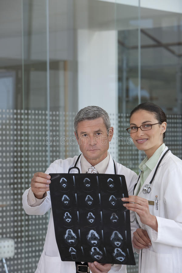 Download Doctors Discussing Xray Results Stock Image - Image: 10470939