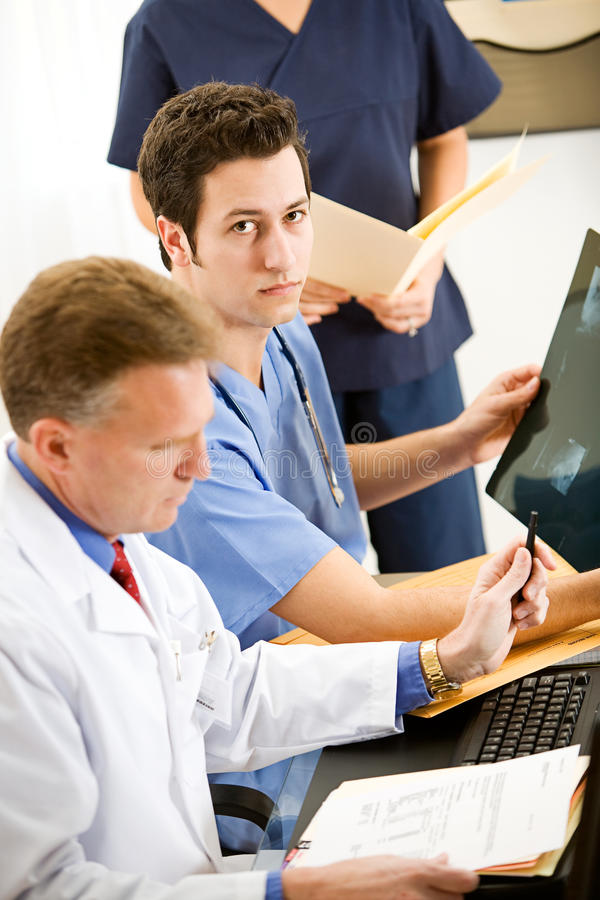 Doctors: Doctor Intern with X-ray royalty free stock photography