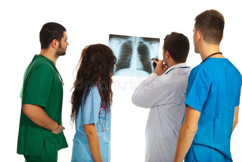 Doctors examine Xray. Dour dosctors examine Xray isolated on white background royalty free stock images