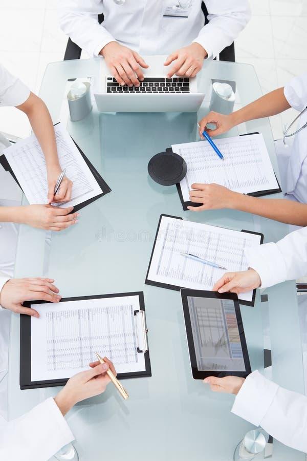 Doctors examining medical reports royalty free stock photo
