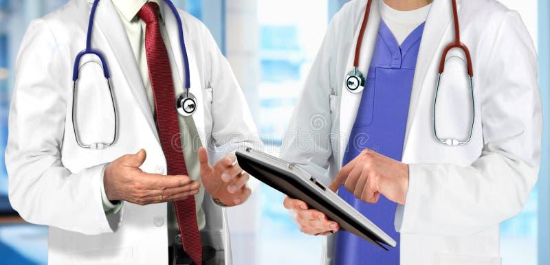 Doctors having discussion regarding patient condition stock photo