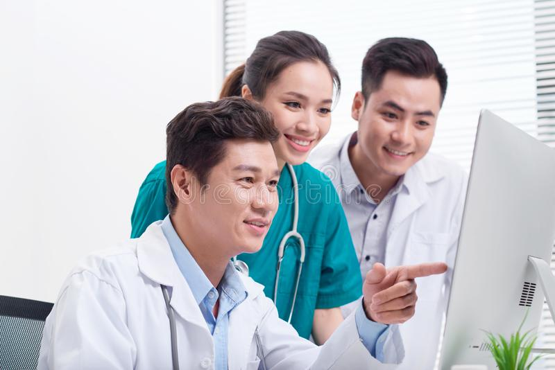 Doctors having a medical discussion in office royalty free stock images