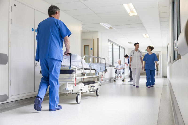 Doctors Hospital Corridor Nurse Pushing Gurney Stretcher Bed stock photography
