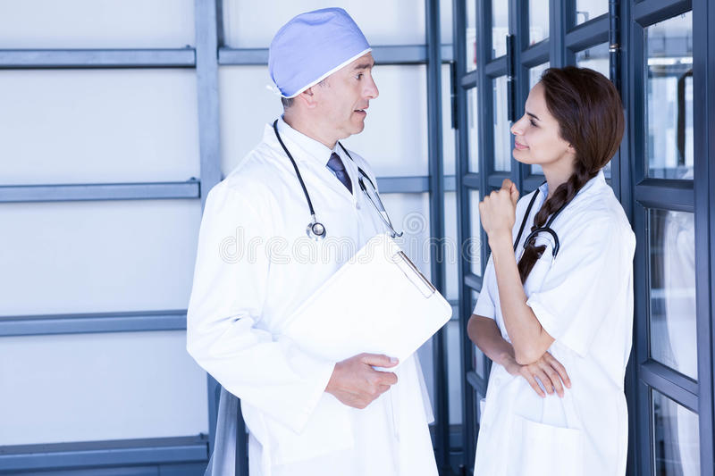 Doctors interacting with each other stock photography