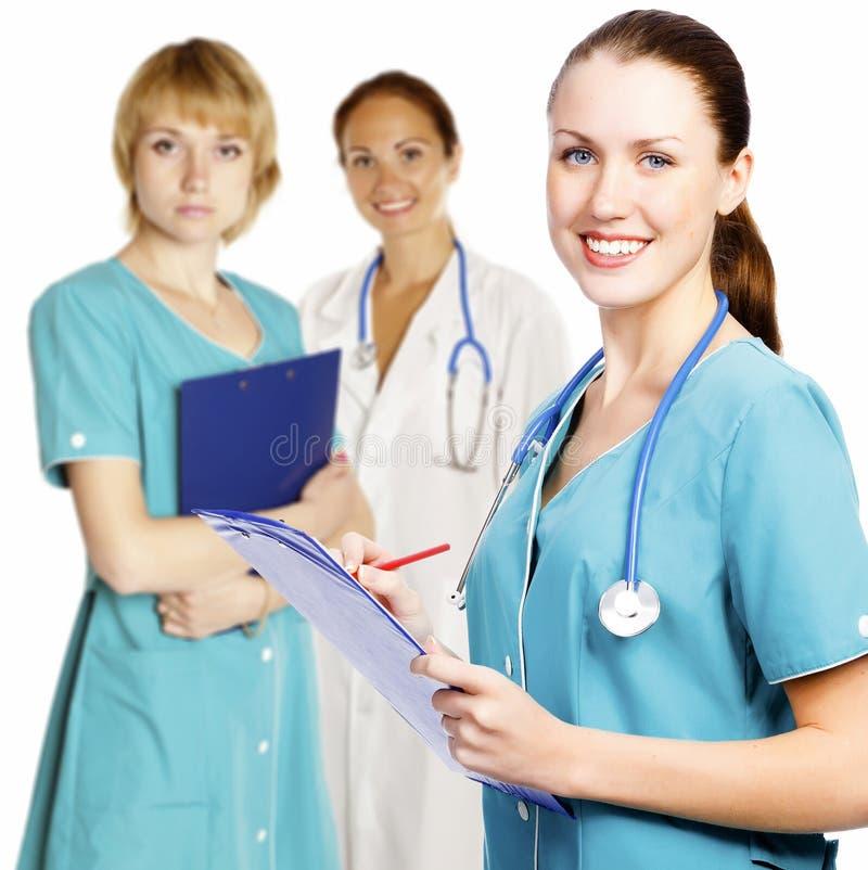 doctors kvinnligsjuksköterskatreen arkivbild