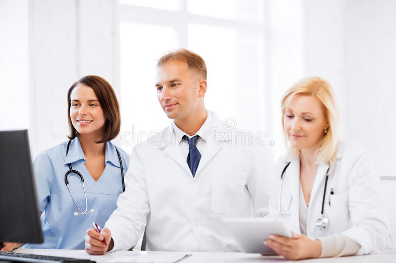 Download Doctors Looking At Computer On Meeting Stock Photo - Image: 33338208