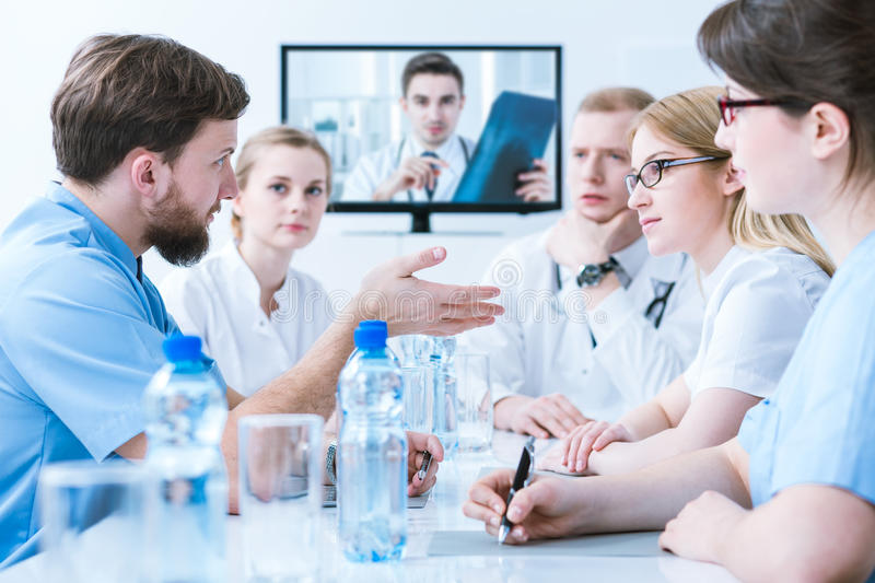 Doctors on medical consultation royalty free stock images