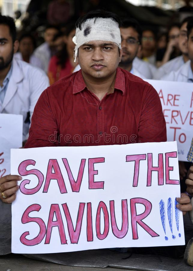 Doctors Nationwide Strike. Guwahati, Assam, India. June 17, 2019. Indian students and doctors of Guwahati Medical College Hospital GMCH hold posters as they royalty free stock image