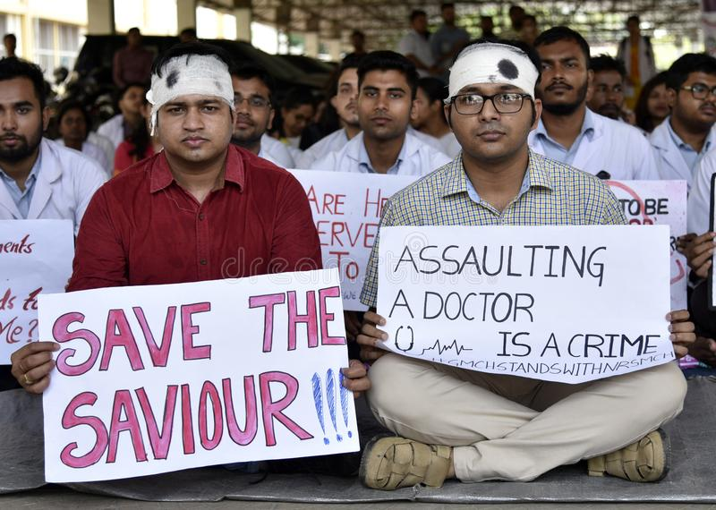 Doctors Nationwide Strike. Guwahati, Assam, India. June 17, 2019. Indian students and doctors of Guwahati Medical College Hospital GMCH hold posters as they stock photo
