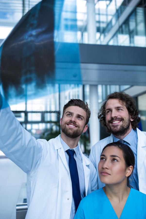 Doctors and nurse examining X-ray report. In hospital royalty free stock photos