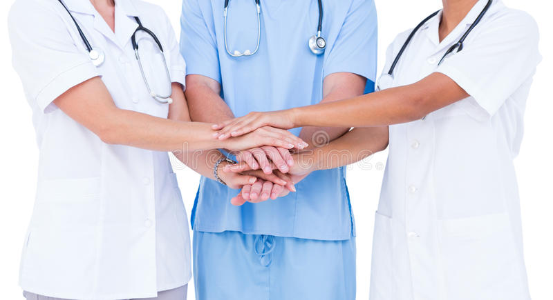 Doctors and nurse putting their hands together stock photos