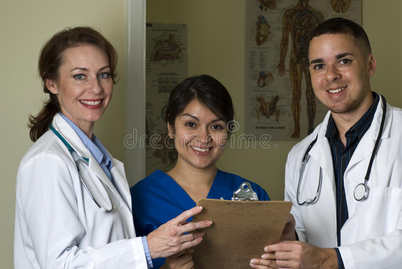 Doctors & Nurse Smiling royalty free stock photos