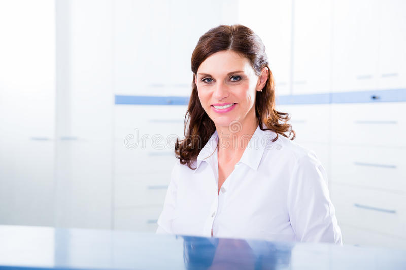 Doctors nurse with telephone in front desk royalty free stock photography