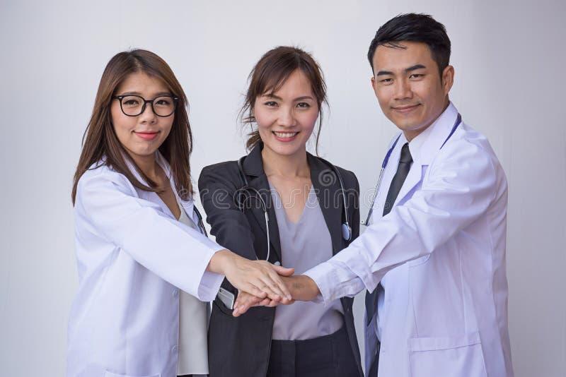 Doctors and Nurses coordinate hands. Concept Teamwork stock photo