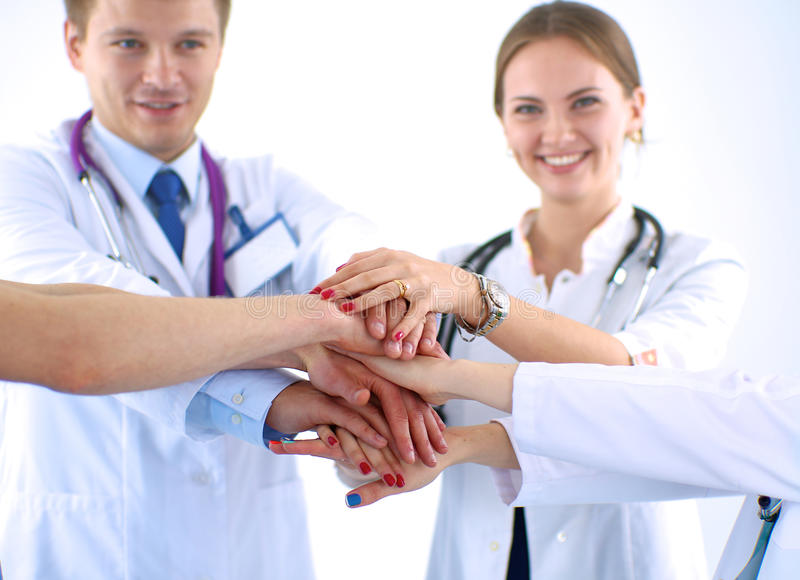 Doctors and nurses in a medical team stacking stock photo