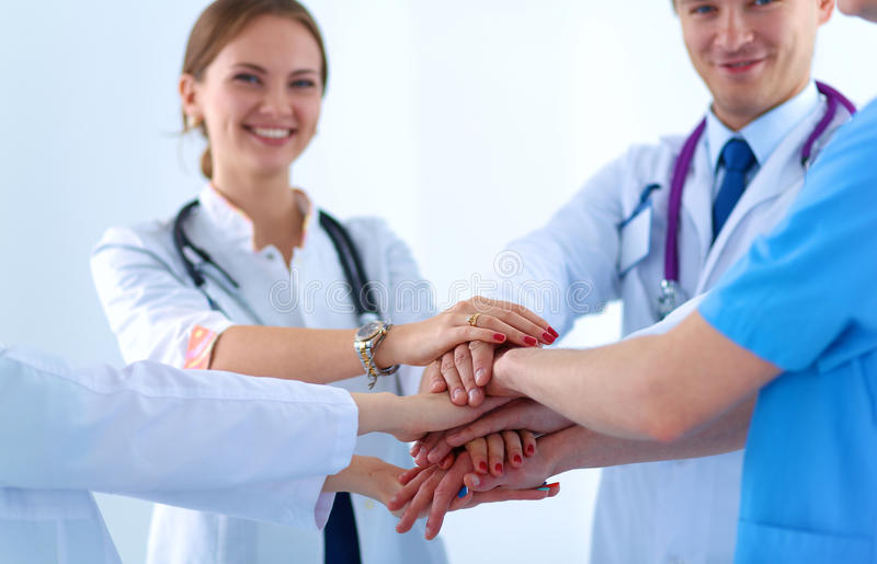 Download Doctors And Nurses In A Medical Team Stacking Stock Image - Image of friendly, meeting: 58600121