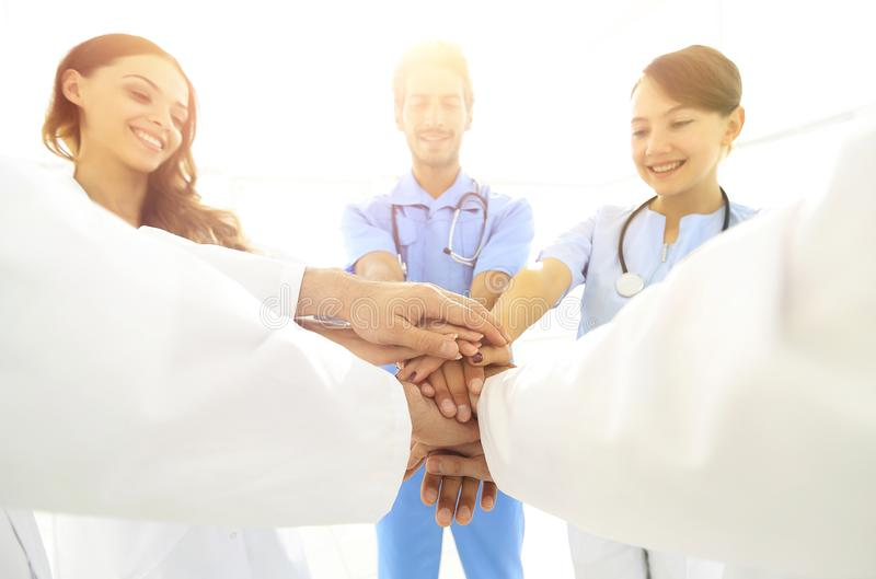 Doctors and nurses in a medical team stacking hands. Concept of unity stock photo