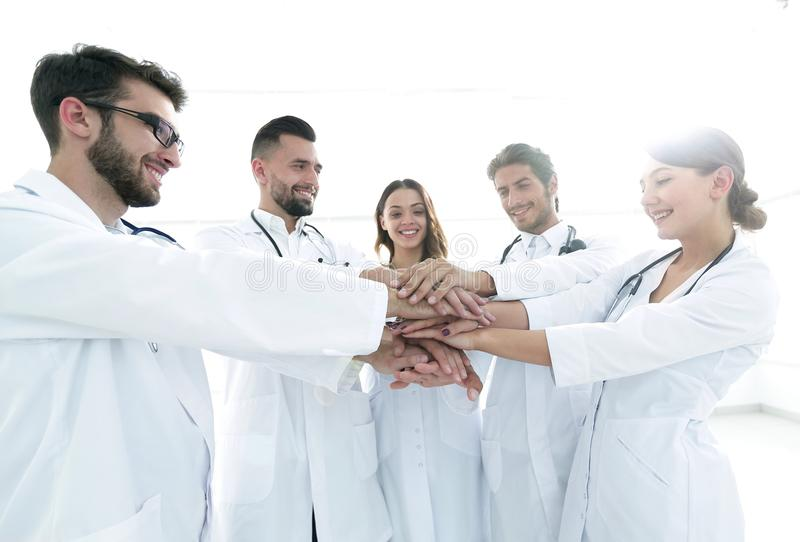 Doctors and nurses in a medical team stacking hands. Concept of teamwork stock images