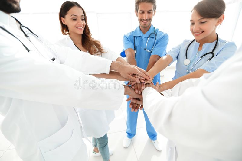 Doctors and nurses in a medical team stacking hands royalty free stock photos