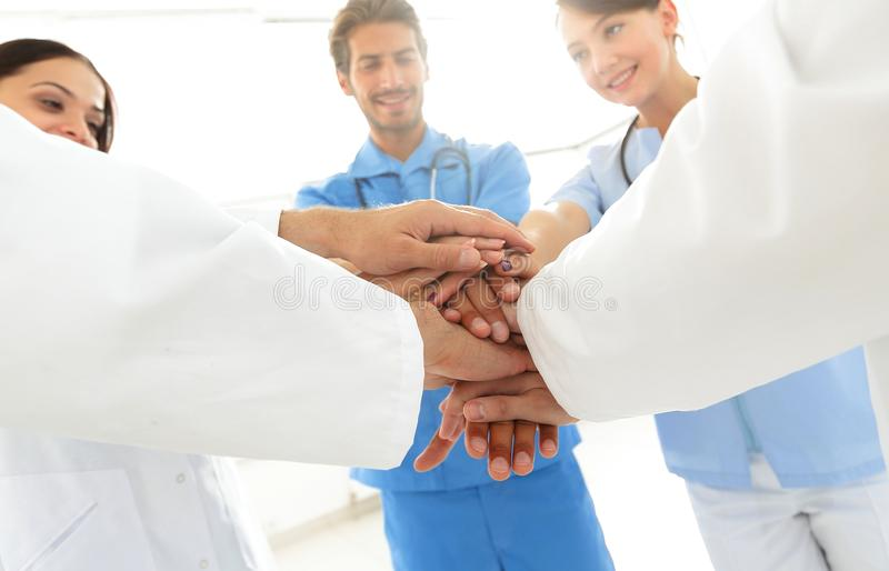 Doctors and nurses in a medical team stacking hands. Concept of unity royalty free stock images