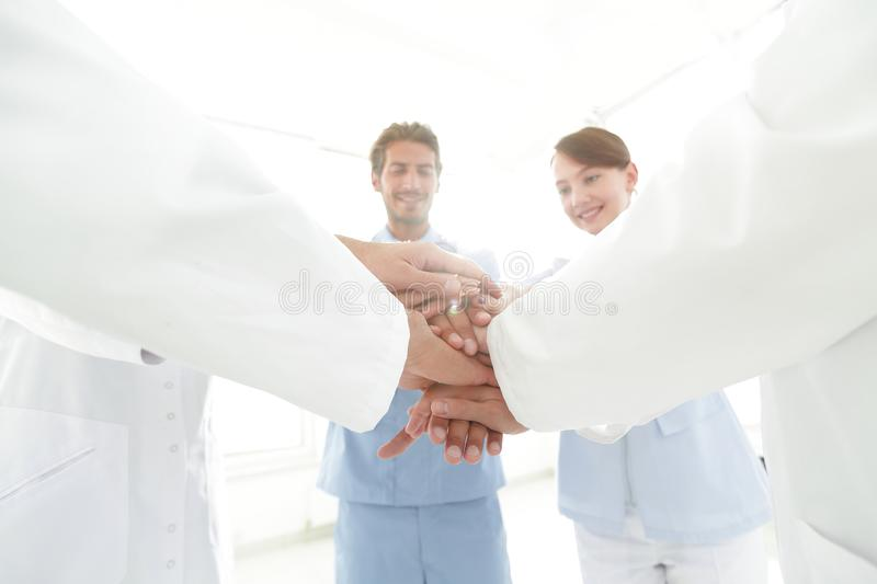 Doctors and nurses in a medical team stacking hands. Concept of unity stock photos