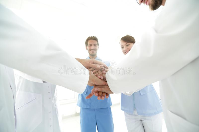 Doctors and nurses in a medical team stacking hands. Concept of unity royalty free stock photos