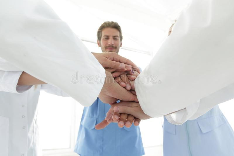 Doctors and nurses in a medical team stacking hands. Concept of unity stock image