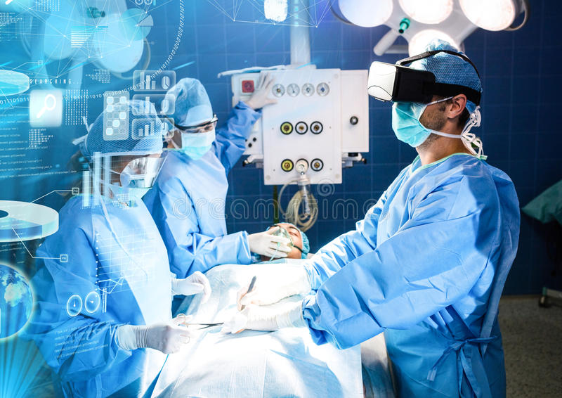 Doctors operating wearing VR Virtual Reality Headset with Interface royalty free stock images
