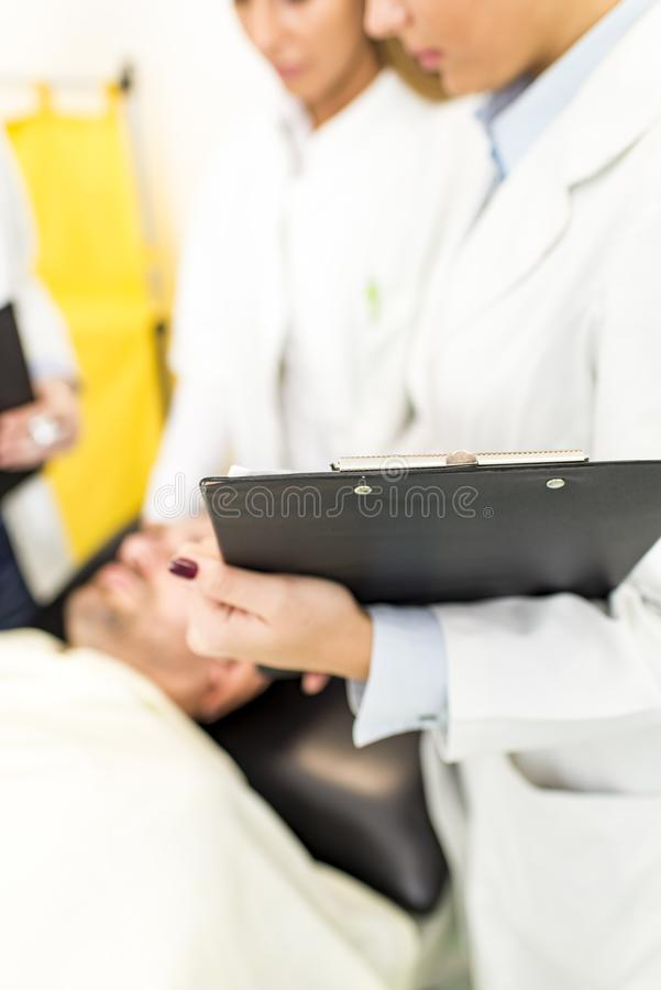 Doctors with patient stock photos