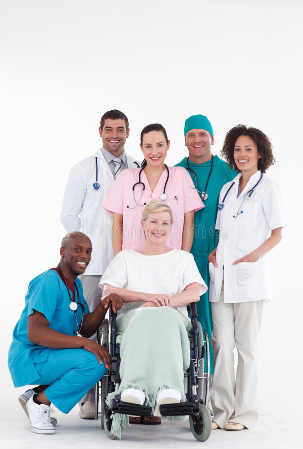 Doctors with a patient in a wheel chair. Group of doctors with a patient in a wheel chair stock photography