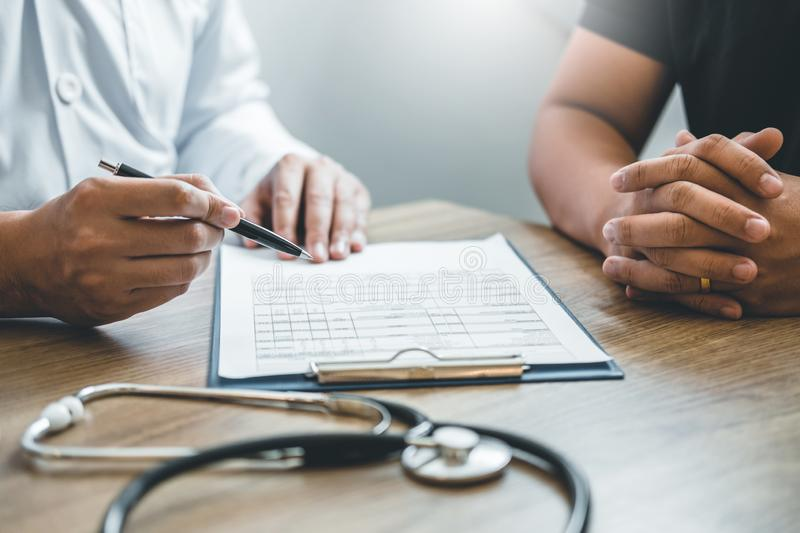 Doctors and patients sit and talk. At the table near the window in the hospital.  stock photos