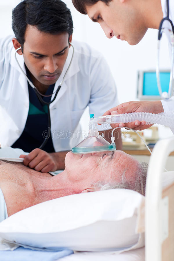 Download Doctors Resuscitating A Senior Patient Stock Image - Image: 12444795
