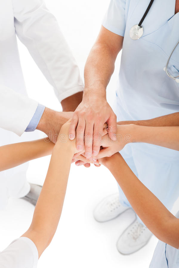 Doctors stacking hands stock images