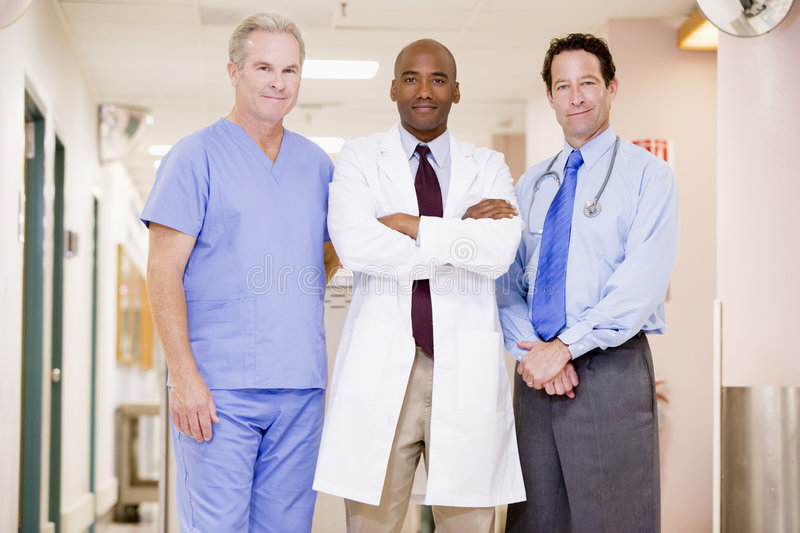 Doctors Standing In A Hospital. Corridor royalty free stock photos
