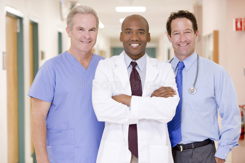 Doctors Standing In A Hospital. Corridor Smiling stock photography