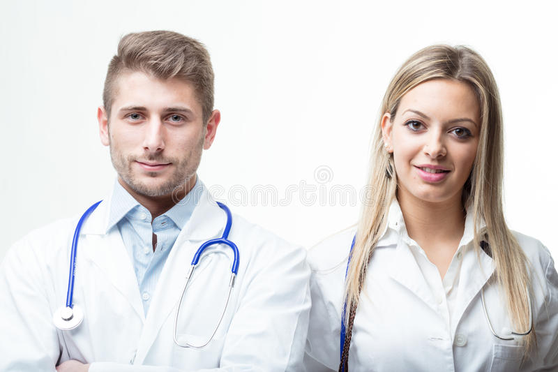 Doctors with stethoscope around their neck smiling at the camera royalty free stock photo