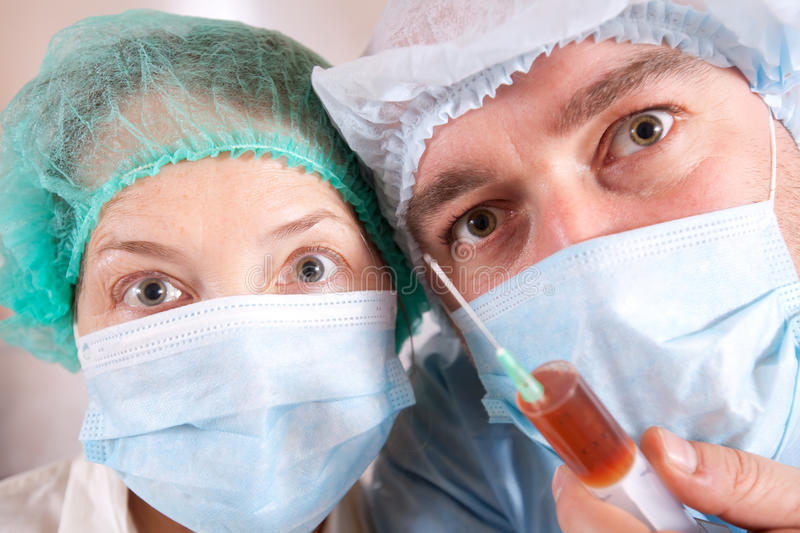 Doctors with syringe. Close up shot of two doctors with syringe royalty free stock image